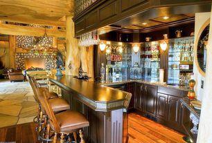 Craftsman Bar with Built-in bookshelf, Hardwood floors, Wall sconce