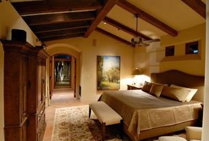 Craftsman Guest Bedroom with Exposed beam, Ceiling fan, picture window, Standard height, stone tile floors, can lights
