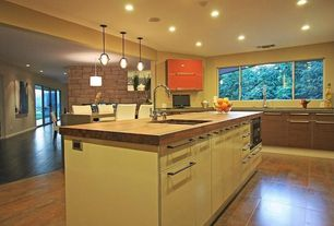 Contemporary Kitchen with Concrete counters, Pendant light, European Cabinets, Armani Fine Woodworking Custom Wood Countertop