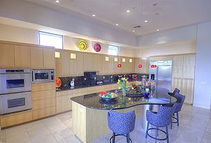 Modern Kitchen with Built In Refrigerator, full backsplash, stone tile floors, built-in microwave, Kitchen island, Quartz
