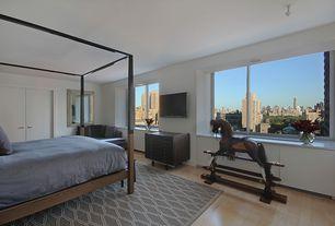 Contemporary Master Bedroom with BDDW Mills Canopy Bed, Laminate floors, Pendant light, H&M King/Queen Linen Duvet Set