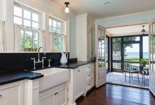 Traditional Kitchen with Pental black soapstone, Screen enclosure, Apron sink - white, Soapstone counters, double-hung window