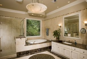 Traditional Master Bathroom with Master bathroom, European Cabinets, Wall sconce, Complex granite counters, Undermount sink