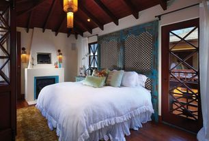 Eclectic Master Bedroom with Wall sconce, Hardwood floors, French doors, Cement fireplace, Casement, can lights, Fireplace