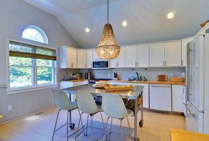 Contemporary Kitchen with dishwasher, Kitchen island, built-in microwave, double-hung window, Flush, Subway Tile, can lights