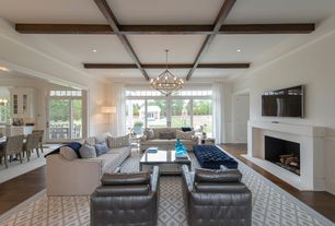 Traditional Living Room with Box ceiling, French doors, Safavieh - chatham gray/ivory moroccan rug, 10'x14', Cement fireplace