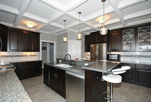 Mediterranean Kitchen with sandstone tile floors, specialty door, Pendant light, built-in microwave, European Cabinets, Flush