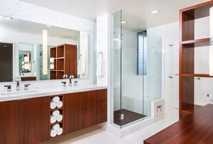Contemporary Master Bathroom with Paint, European Cabinets, can lights, Corian counters, linen and towel storage cabinet