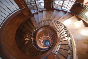 Traditional Staircase with Hardwood floors, Wall sconce, Wrought iron railing, High ceiling, Finished wood staircase