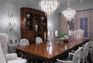 Traditional Dining Room with Wall sconce, Chandelier, High ceiling, Laminate floors, can lights, Casement