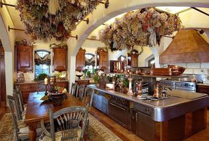 Country Kitchen with U-shaped, double oven range, Exposed beam, wall oven, Arched window, Stainless steel counters