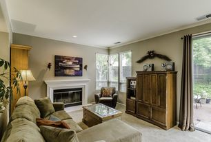 Country Living Room with Carpet, Fireplace, Cement fireplace, Standard height, picture window, Casement, Crown molding