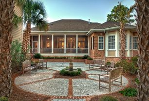 Tropical Patio with exterior stone floors, Pathway, Bird bath, Transom window, Raised beds, French doors