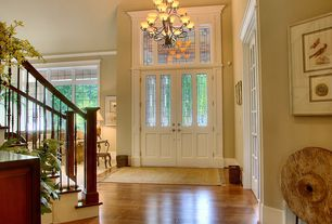 Traditional Entryway with Hardwood floors, Chandelier, French doors, Transom window, High ceiling