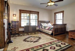 Craftsman Guest Bedroom with Ceiling fan, Hardwood floors, Standard height, can lights, double-hung window