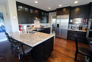 Traditional Kitchen with L-shaped, double wall oven, Breakfast bar, Paint, can lights, Flat panel cabinets, full backsplash