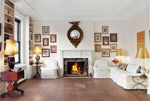 Traditional Living Room with Standard height, Hardwood floors, stone fireplace, Fireplace, Built-in bookshelf, Crown molding