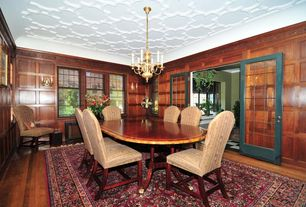 Traditional Dining Room with Crown molding, Hardwood floors, Chandelier, French doors, Wall sconce
