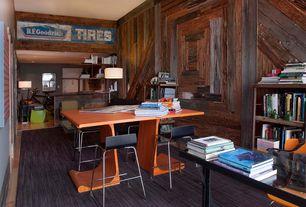 Modern Home Office with Built-in bookshelf, flat door, can lights, double-hung window, High ceiling, Hardwood floors