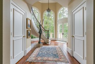 Traditional Entryway with Pendant light, French doors, High ceiling, Arched window, Hardwood floors