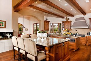 Country Kitchen with Framed Partial Panel, warming oven, Casement, Breakfast bar, Large Ceramic Tile, Exposed beam, U-shaped