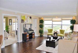 Eclectic room with Hardwood floors, Crown molding, French doors, specialty door