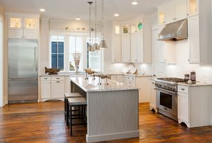 Traditional Kitchen with Stone Tile, Pendant light, Flat panel cabinets, Flush, Breakfast bar, Limestone Tile, L-shaped