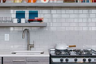"Contemporary Kitchen with European Cabinets, Subway Tile, Flush, Corian counters, White quartz countertop in ""snowstorm"""