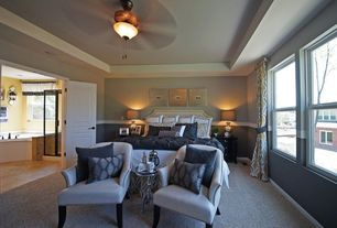 Traditional Master Bedroom with Standard height, double-hung window, Chair rail, Carpet, flush light, specialty door