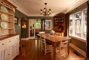 Country Dining Room with Glass panel door, Chandelier, Built-in bookshelf, Hardwood floors