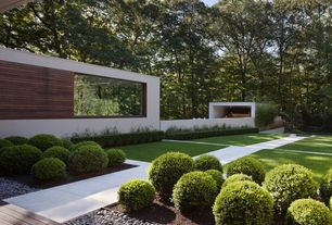 Modern Landscape/Yard with exterior tile floors, Pathway, Raised beds