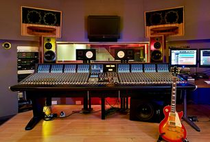 Contemporary Basement with Duality mixing console, Dean street studios, Recording studio, Built-in bookshelf, Laminate floors