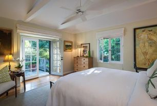 Traditional Master Bedroom with Exposed beam, French doors, Hardwood floors, Ceiling fan