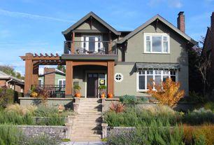 Craftsman Exterior of Home with Octagonal 2-bars window, Glass panel door, Lavender bush, Raised beds, Pathway, Trellis