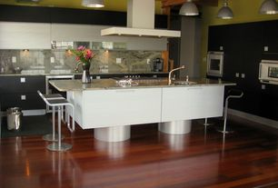 Modern Kitchen with wall oven, Wine refrigerator, High ceiling, Pendant light, Island Hood, electric cooktop, can lights