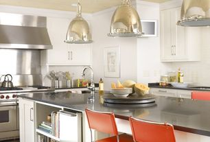 Modern Kitchen with Pendant light, full backsplash, double oven range, Stainless steel counters, Simple granite counters