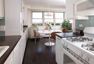 Contemporary Kitchen with Large Ceramic Tile, Insect Stackable Dining Chair - Walnut Wood, Wood counters, Flush, Galley