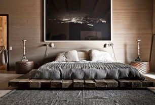 Contemporary Master Bedroom with Ile-de-re, france, Carpet, Sander iron coffee table, Wide plank floors, Earthy color palette