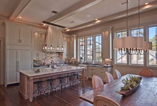 Traditional Kitchen with Casement, Inset cabinets, Soapstone counters, Kitchen island, Pendant light, Flat panel cabinets