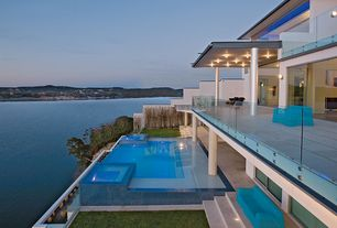Modern Swimming Pool with exterior concrete tile floors, Infinity pool, picture window, Deck Railing, sliding glass door