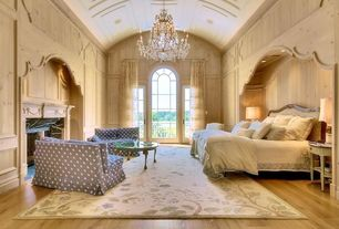 Traditional Master Bedroom with Hardwood floors, Chandelier, High ceiling, Arched window, French doors, Box ceiling
