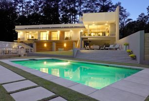 Modern Swimming Pool with French doors, exterior tile floors, Pathway