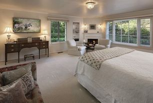 Traditional Master Bedroom with Wall sconce, flush light, Cement fireplace, Crown molding, Carpet