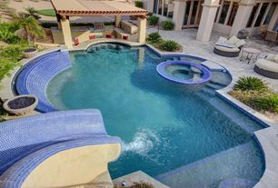Traditional Swimming Pool with exterior stone floors, Raised beds, Outdoor kitchen, Pool with hot tub, Trellis, Fire pit