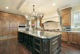 Mediterranean Kitchen with Chestnut wood stain, Simple granite counters, Inset cabinets, Empress green marble, Chandelier