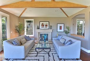 Contemporary Living Room with stone fireplace, High ceiling, Exposed beam, Hardwood floors