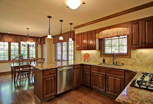 Craftsman Kitchen with Ms international baltic brown classic granite, Inset cabinets, Pendant light, Raised panel, U-shaped