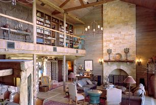 Rustic Great Room with Wall sconce, Exposed beam, Built-in bookshelf, Ceiling fan, Fireplace, Cathedral ceiling, slate floors