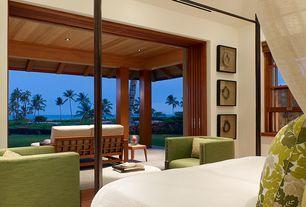 Tropical Master Bedroom with Hardwood floors, Columns