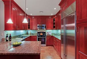 Traditional Kitchen with Ms international - giallo napolean, Flat panel cabinets, Undermount sink, Kitchen peninsula, Flush